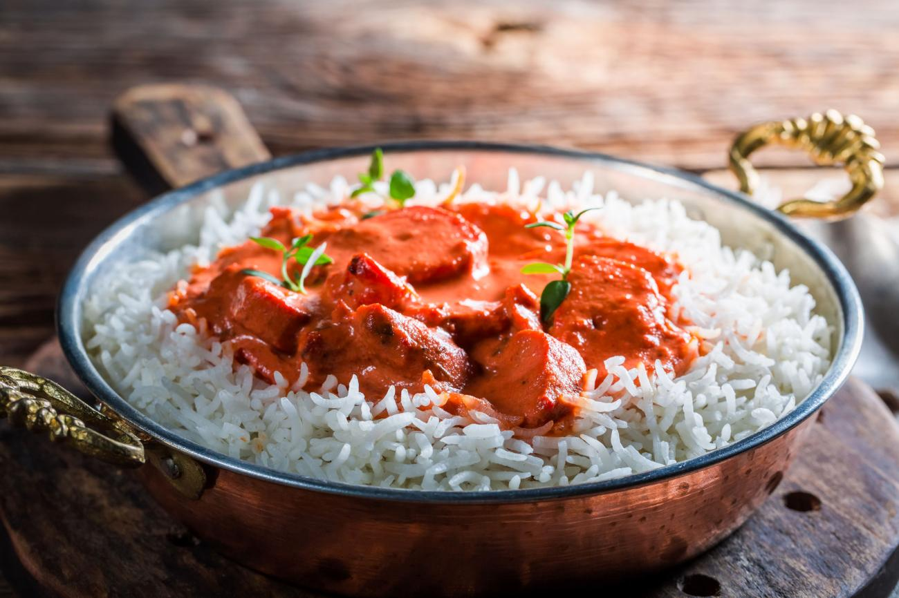 Sweet and spicy tikka masala with rice and tomato sauce